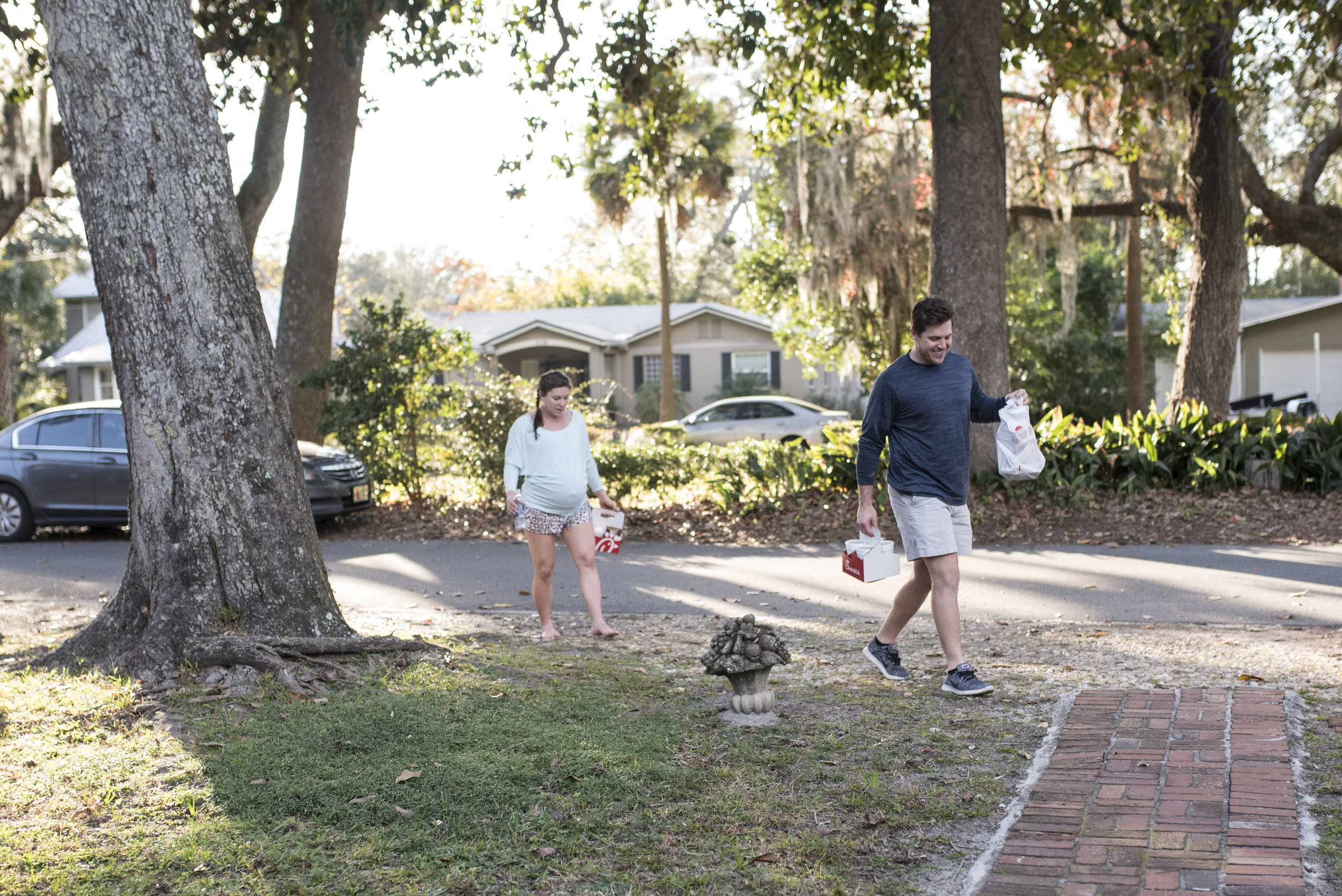 Couple walks in from the front yard with Chick-fil-a for the birth team.