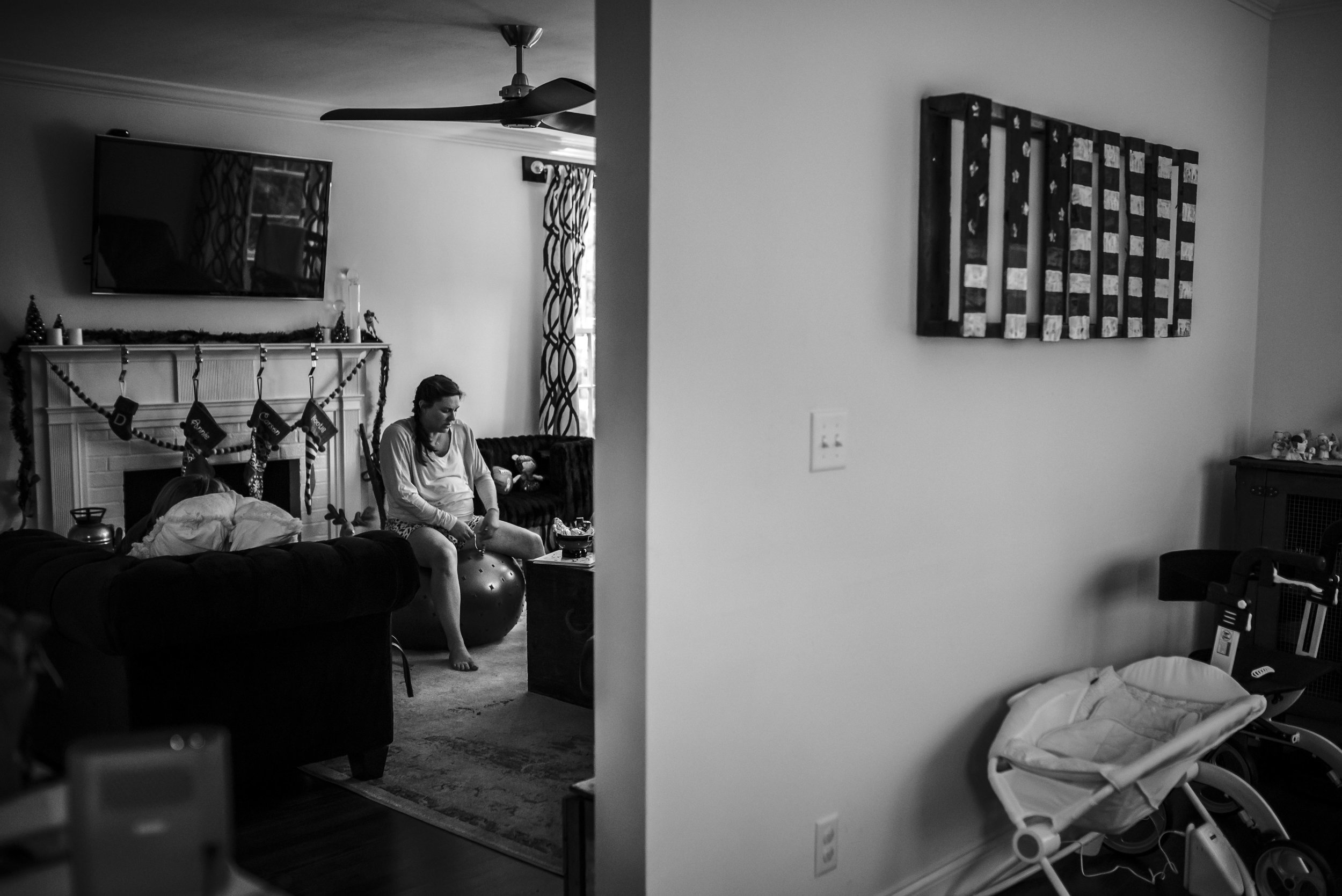 Mother labors on a birth ball in her home in Jacksonville, Florida.