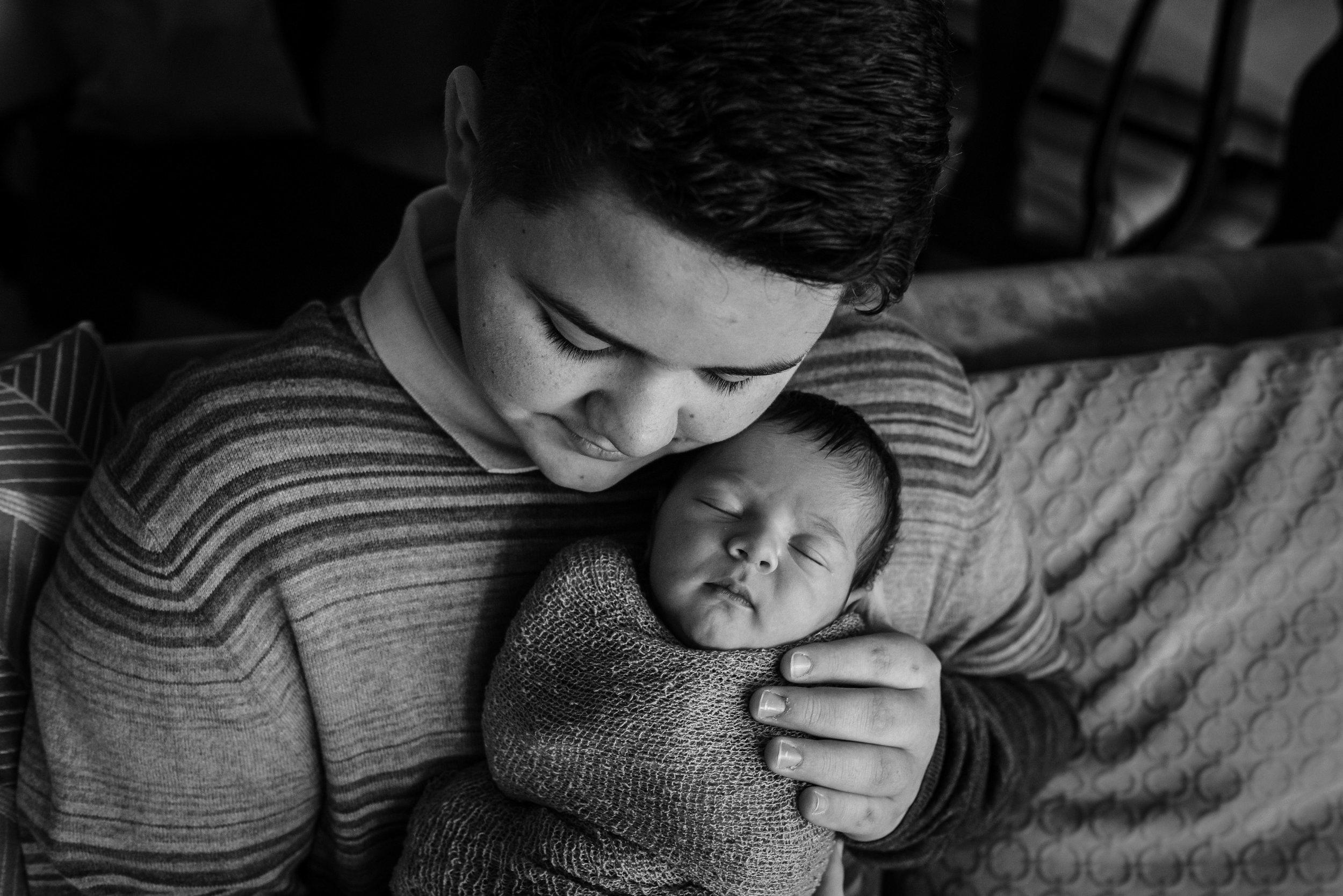 thirteen-year-old-big-brother-holds-newborn