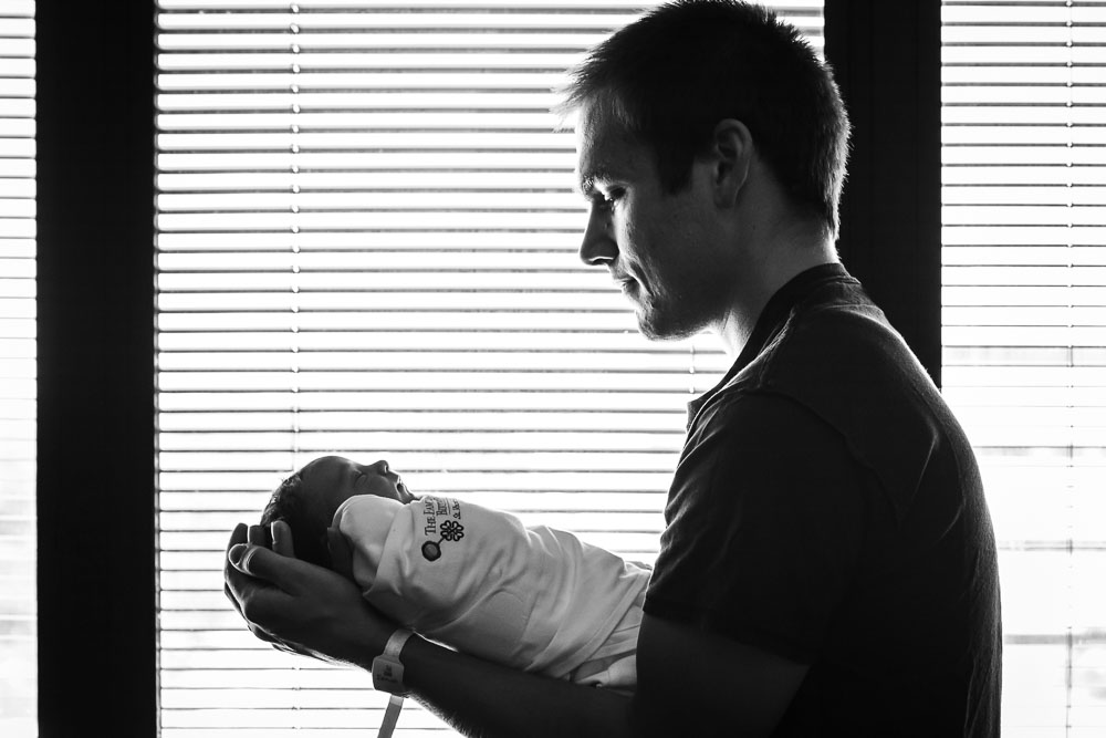 A first time dad holds his new baby girl at St. Vincent's Southside in Jacksonville, Florida. She was born via C-section after a long labor and eventually being found in a breech position.