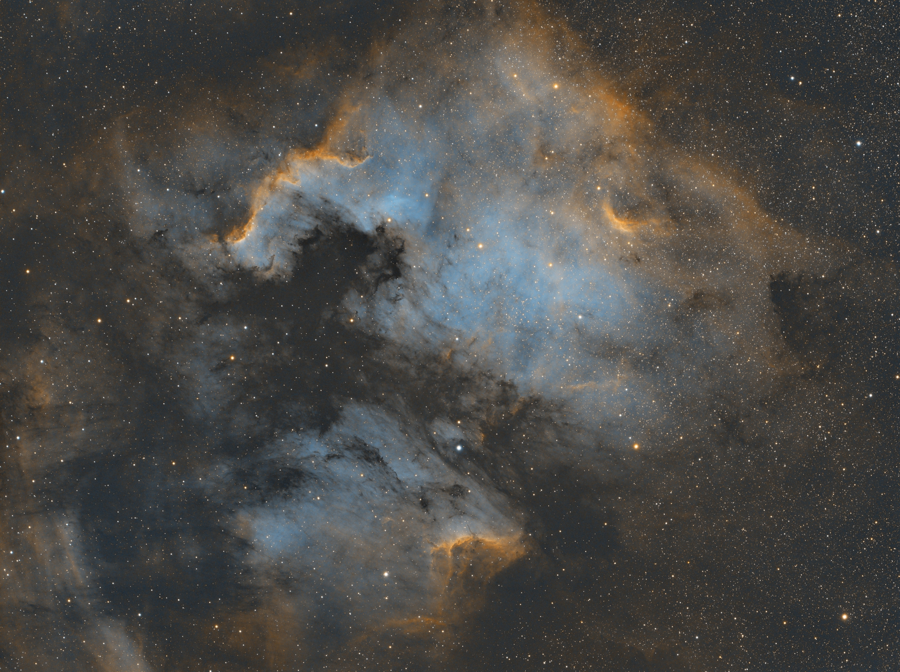 This is the North American Nebula (NGC 7000) along with the Pelican Nebula (IC1050). I captured this over 4-5 nights for a total of about 16 hours. It's All narrowband, Hydrogen Alpha, Oxygen III, and Nitrogen II.
