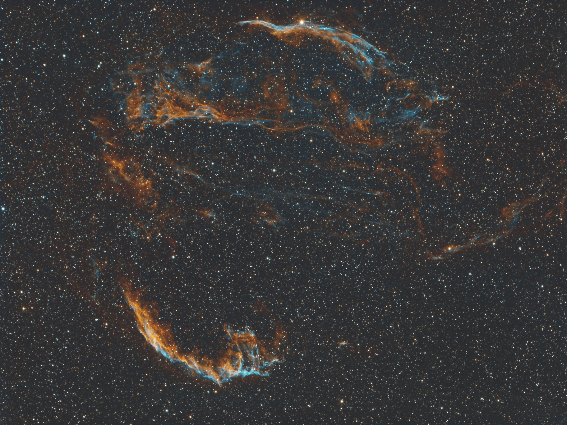The Veil Nebula, which is a supernova remnant. Its circular shape is the expanding gas from a star's explosion. Pretty cool. This was a quick shot, just three hours each of Hydrogen Alpha and Oxygen III filters.