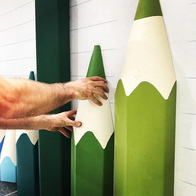 Install begins! ✏️✏️✏️ . . . . .  #bts #handpainted #slowandsteady #finerdetails #yellowpaint #installationart #brush #walldecor #artandcraft #kidsdesign #pencildesign #visualmerchandising #vmlife #productiondesign #propstylist #custommade #madetoorder #artistatwork #aminiconcepts #thestyledgroup #visiondesigncreate #rainbowcolours #colourcrush #colourpalette #installationart