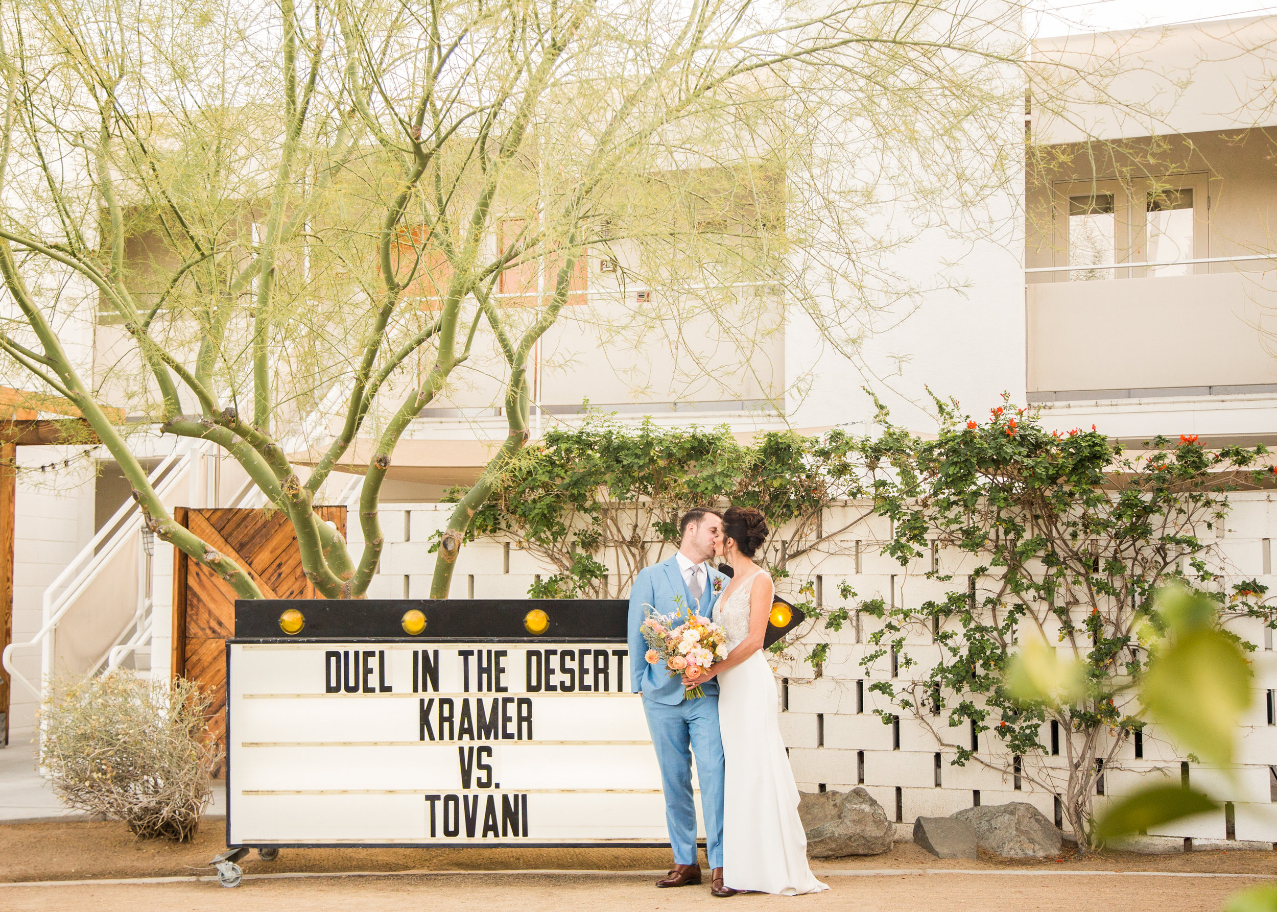 Couple kissing in front of Marquee and Ace Hotel and Swim Palm Springs