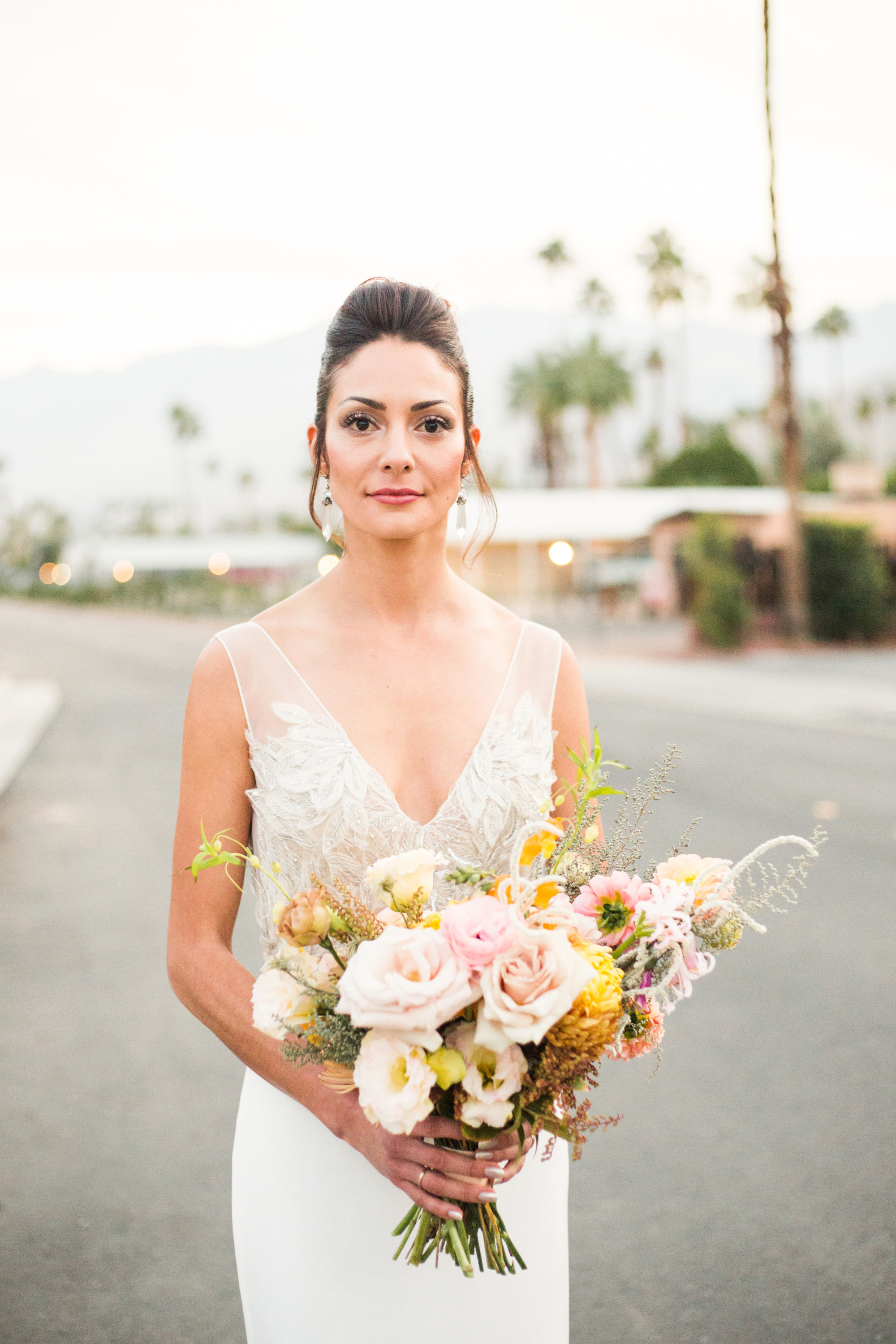 Beautiful bride with colorful desert inspired boquet