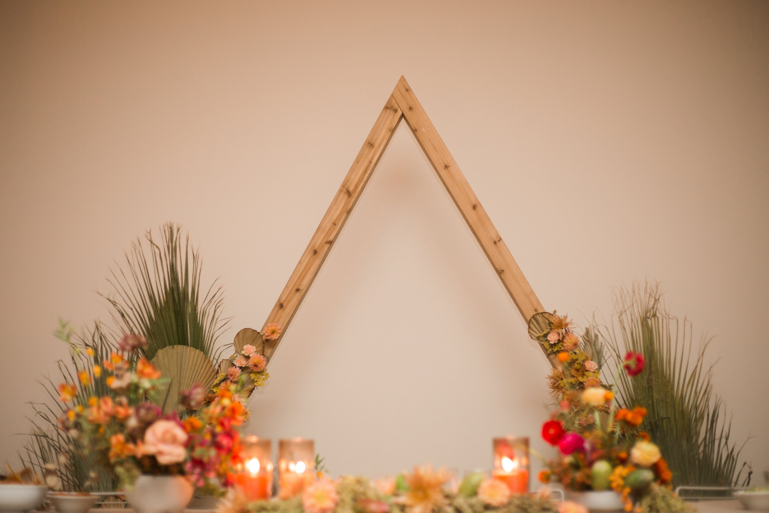 Desert inspired florals and triangle arch at Ace Hotel Palm Springs