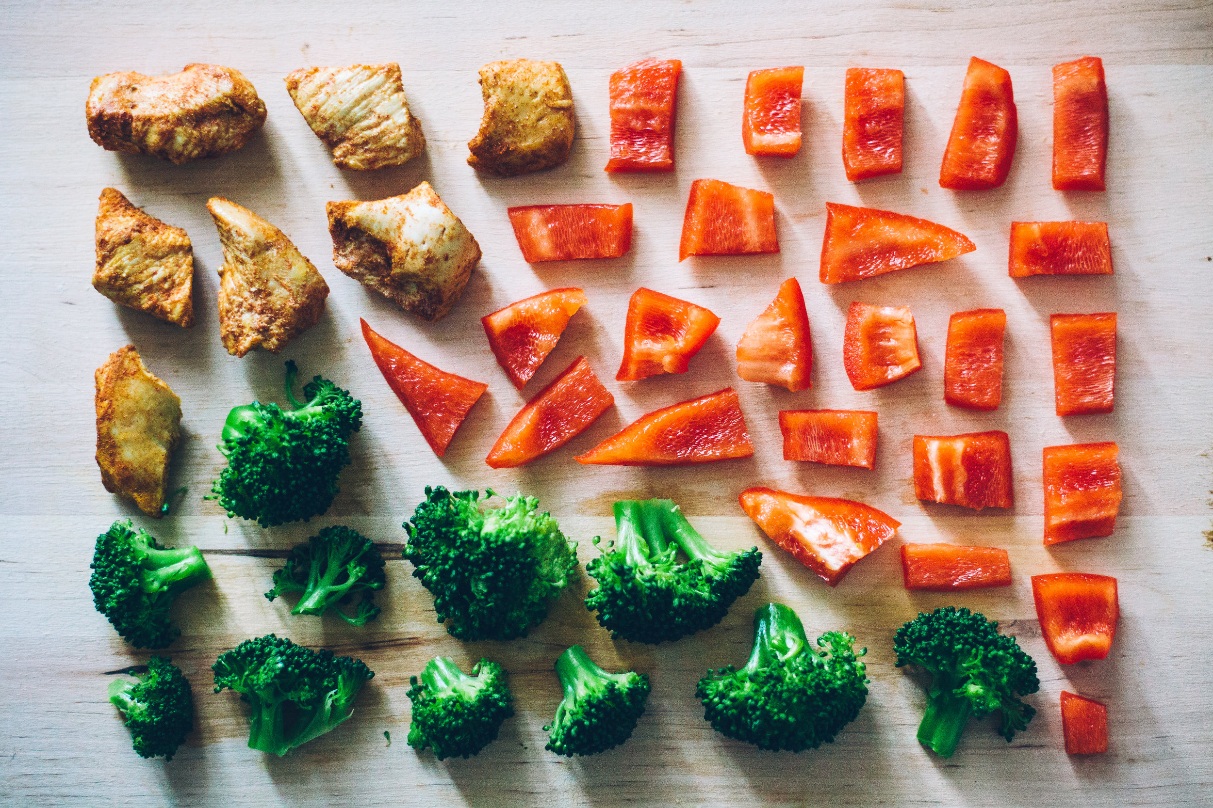 veggies and chicken on a cutting board.jpg