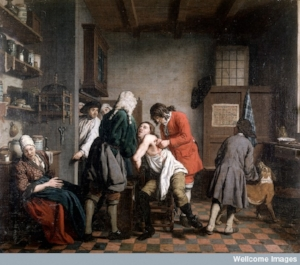Interior with a surgeon attending to a wound in a man's side