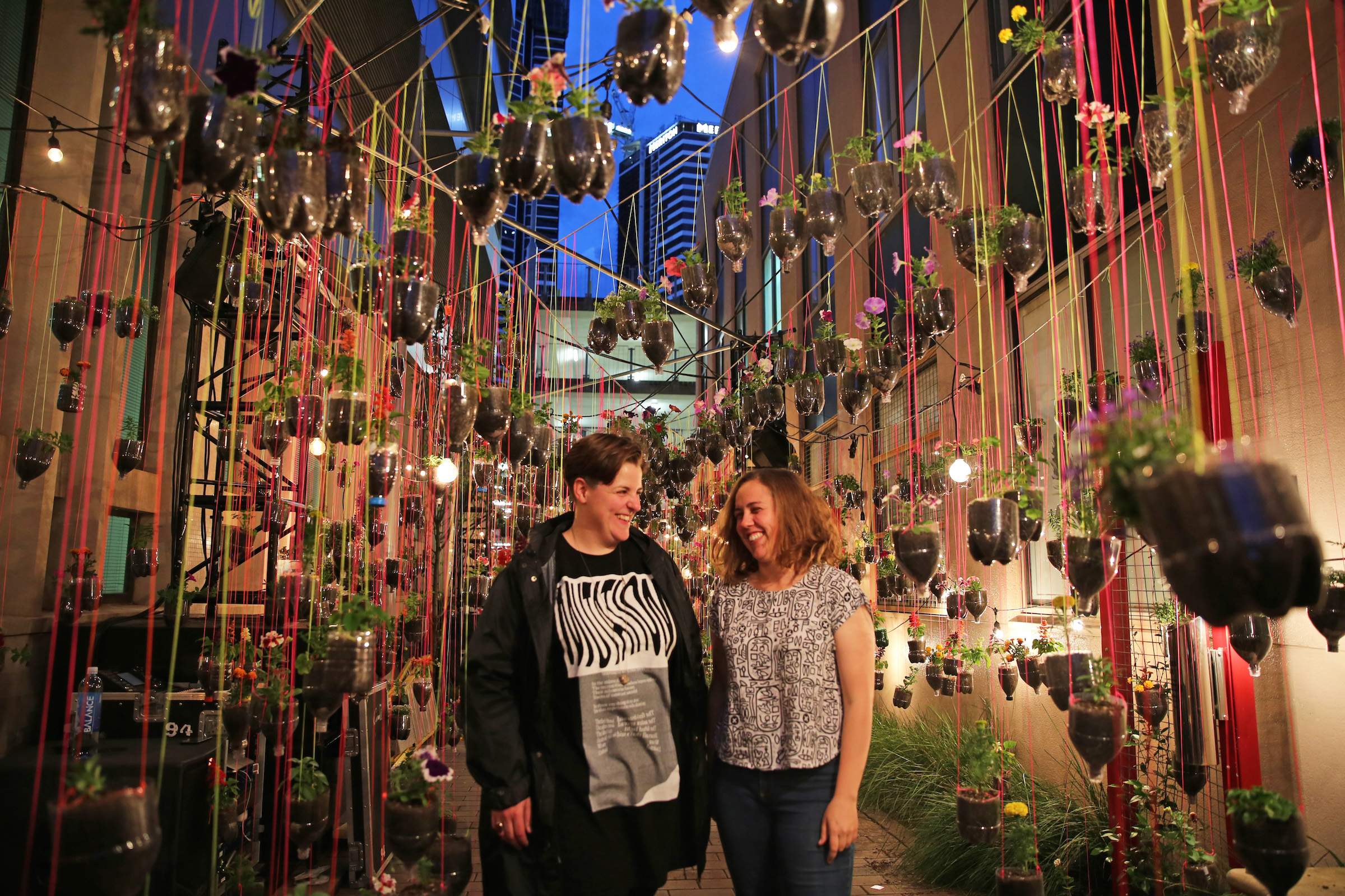 an immersive and interactive artwork created by artists anna mcmahon and annie mckinnon. working with the parramatta community, the artists created over 1000 hanging planters out of recycled plastics housing a range of edible and lifestyle plants. an interactive sound trail was created through the hanging garden featuring interviews with local school children involved in the project. commissioned by the city of parramatta council and supported through the NSW environment protection authority.