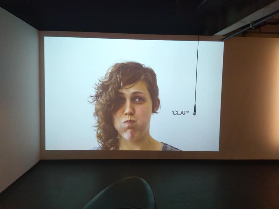 an interactive video work that features a projection of annie's face, holding its breath. when you clap, the she breathes in, when you clap again she breathes out. the work is a comment on control. commissioned by casula powerhouse arts centre. concept by annie mckinnon, director of about turn.