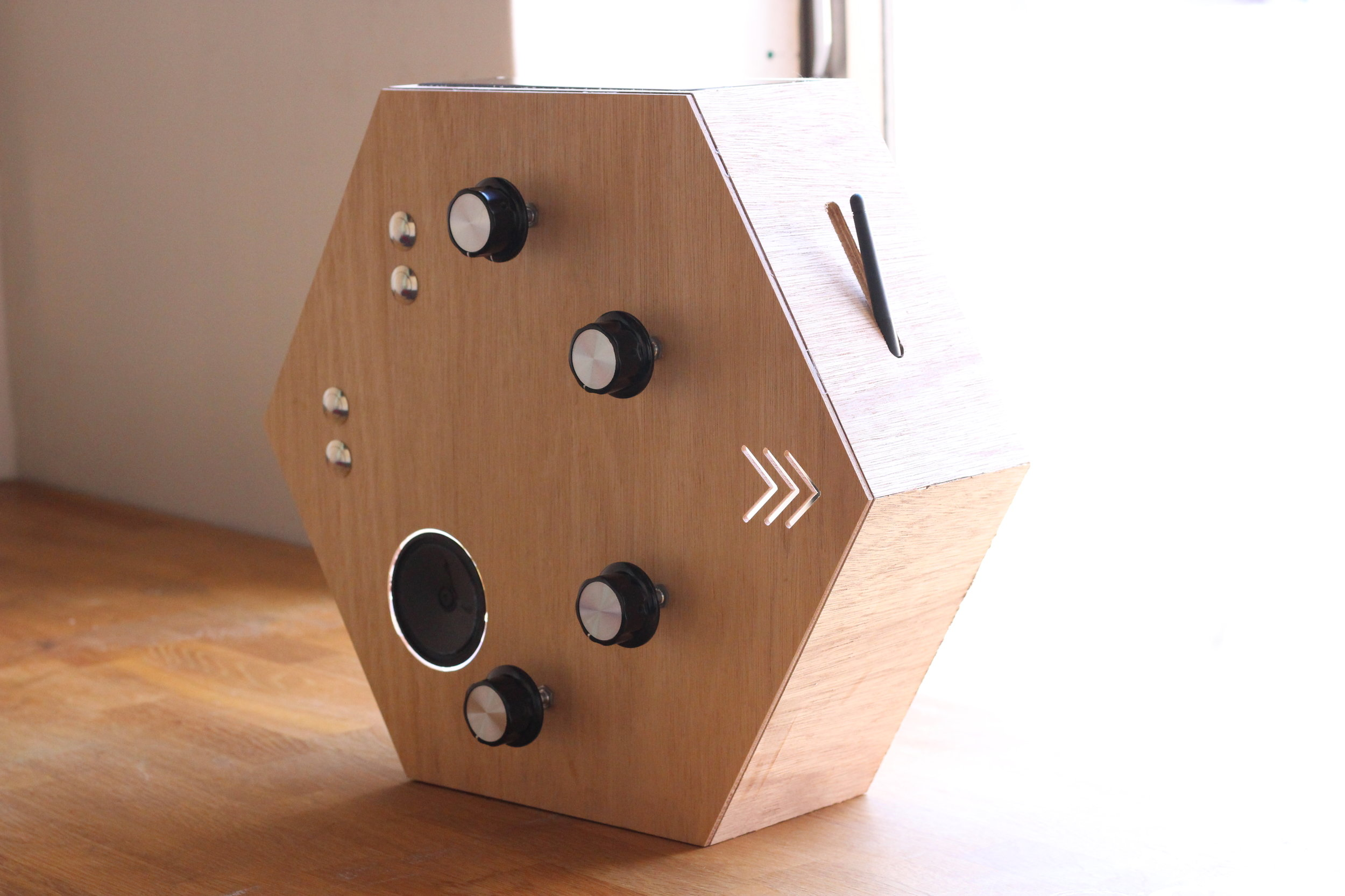 a collection of three interactive objects (like the one pictured to the right) with dials and buttons. each object can speak to one another from up to 10km away. made from marine plywood and vandal-proof components. pass it on was commissioned by the think+do tank foundation in an effort to help people with no common language connect anonymously with music, an international language.