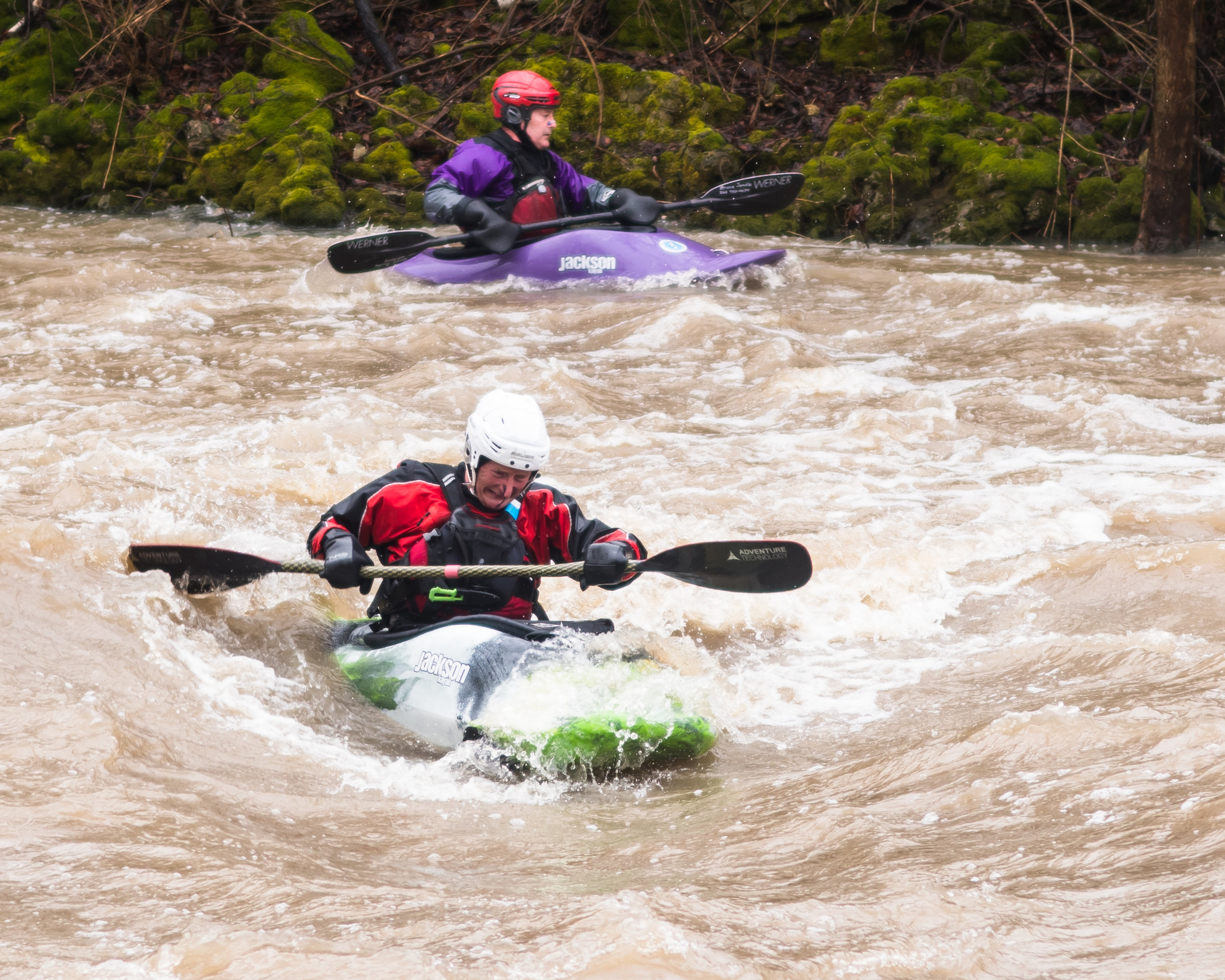 Whitewater kayakers Bruce Jondle and Jozef Milewsski fight through the rapids of the Root River during rainy conditions on Sunday