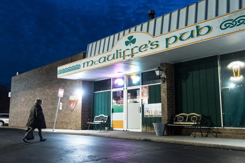 Bartender Tina Paukstelis walks into McAuliffe's Pub for The Parkside Reunion Big Band's bi-weekly performance on April 4.
