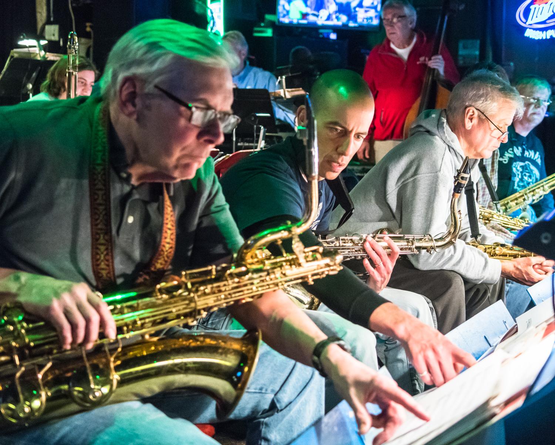 Jim Lemke, baritone saxophone, and Jordan Gardina, tenor saxophone, prepare their music for the first of many selections.