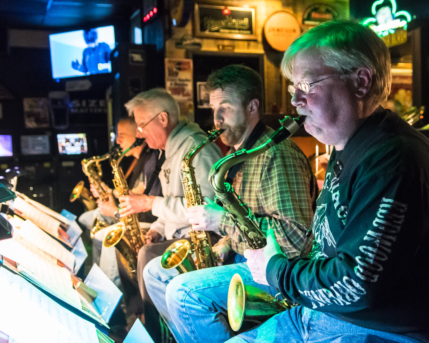(Right to Left) Patrick Odell, tenor Saxophone, plays along with Garrett Kornman, alto saxophone, and Steve Jacob, alto saxophone, during The Parkside Reunion Big Band's bi-weekly performance on April 4 at McAuliffe's Pub.