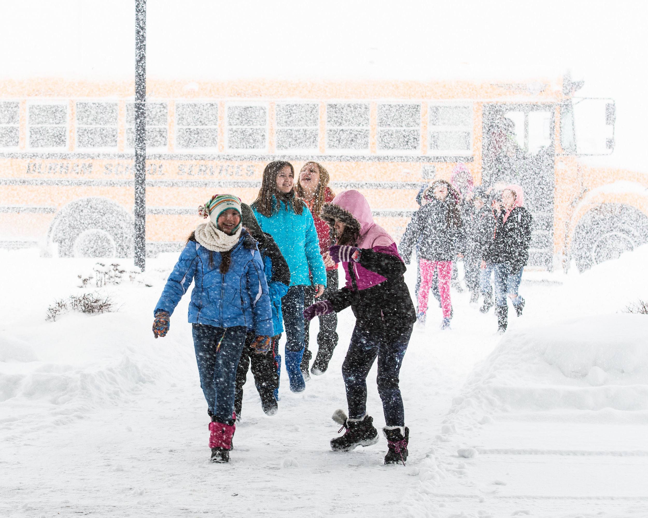 Fifth graders from Olympia Brown Elementary brave the morning winter gusts as they enter Grace Church for the Racine Symphony Orchestra Concert.