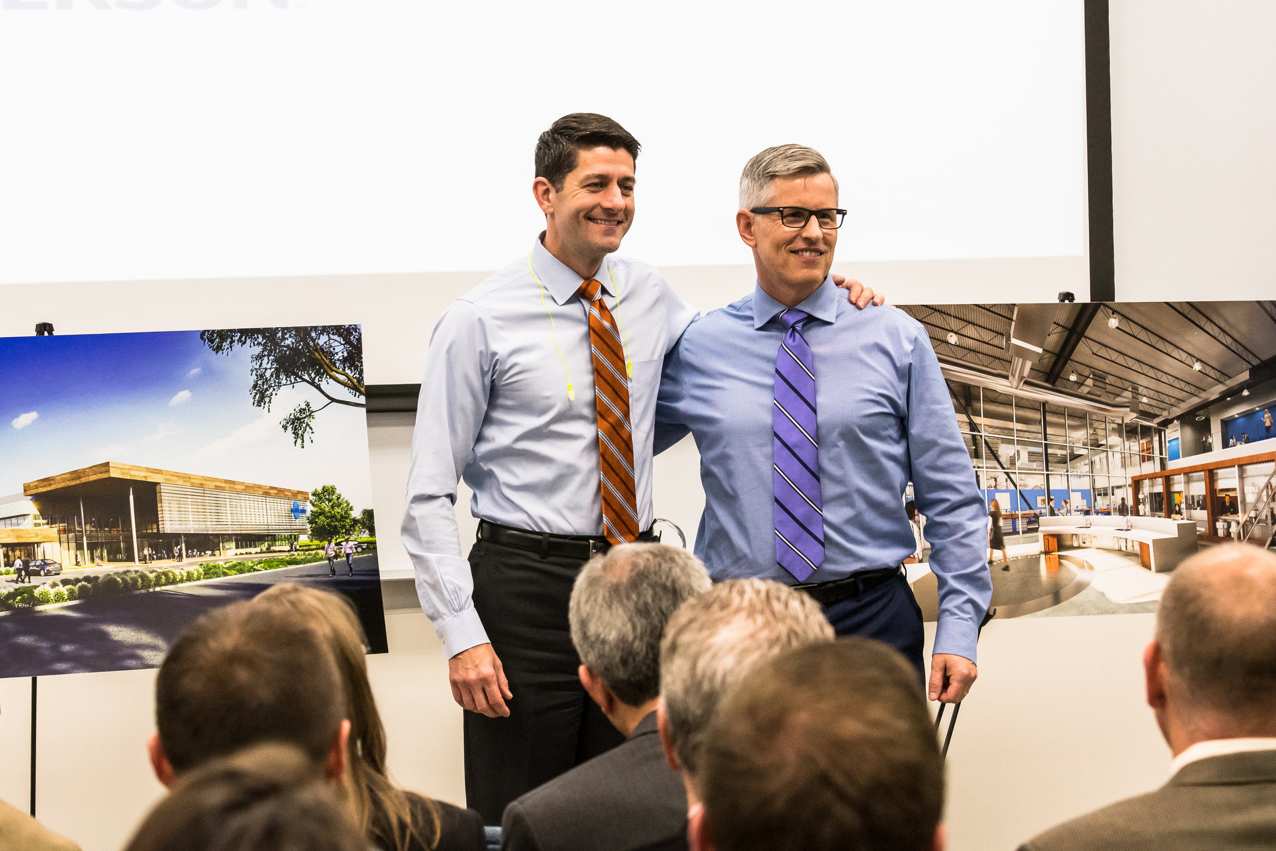Congressman and House Speaker Paul Ryan and President of InSinkErator Chad Severson pose with renderings of InSinkErator's new headquarters and facility at InSinkErator in Racine Thursday morning.