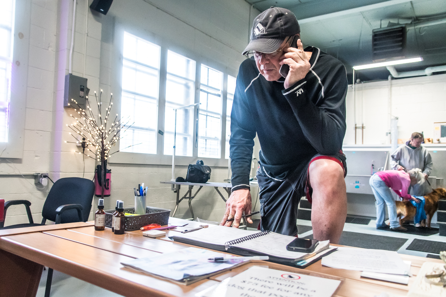 Owner of Club Aqua Paws, Mike Iwon, Racine, takes calls between clients at his business on Lathrop Ave in Downtown Racine.