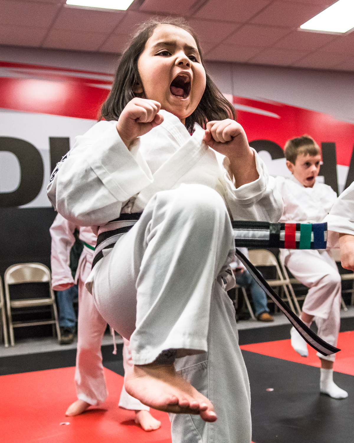 Natalia Padilla, 6, practices her kneeing along with her Little Dragons karate class at Black Belt Karate in downtown Racine Friday night.