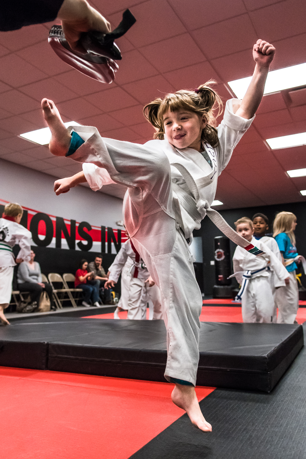 Five year old Lucy Worrell, Racine, soars into the air for a jump kick as she participates in her Little Dragons Karate class at Black Belt Karate in downtown Racine Friday night.