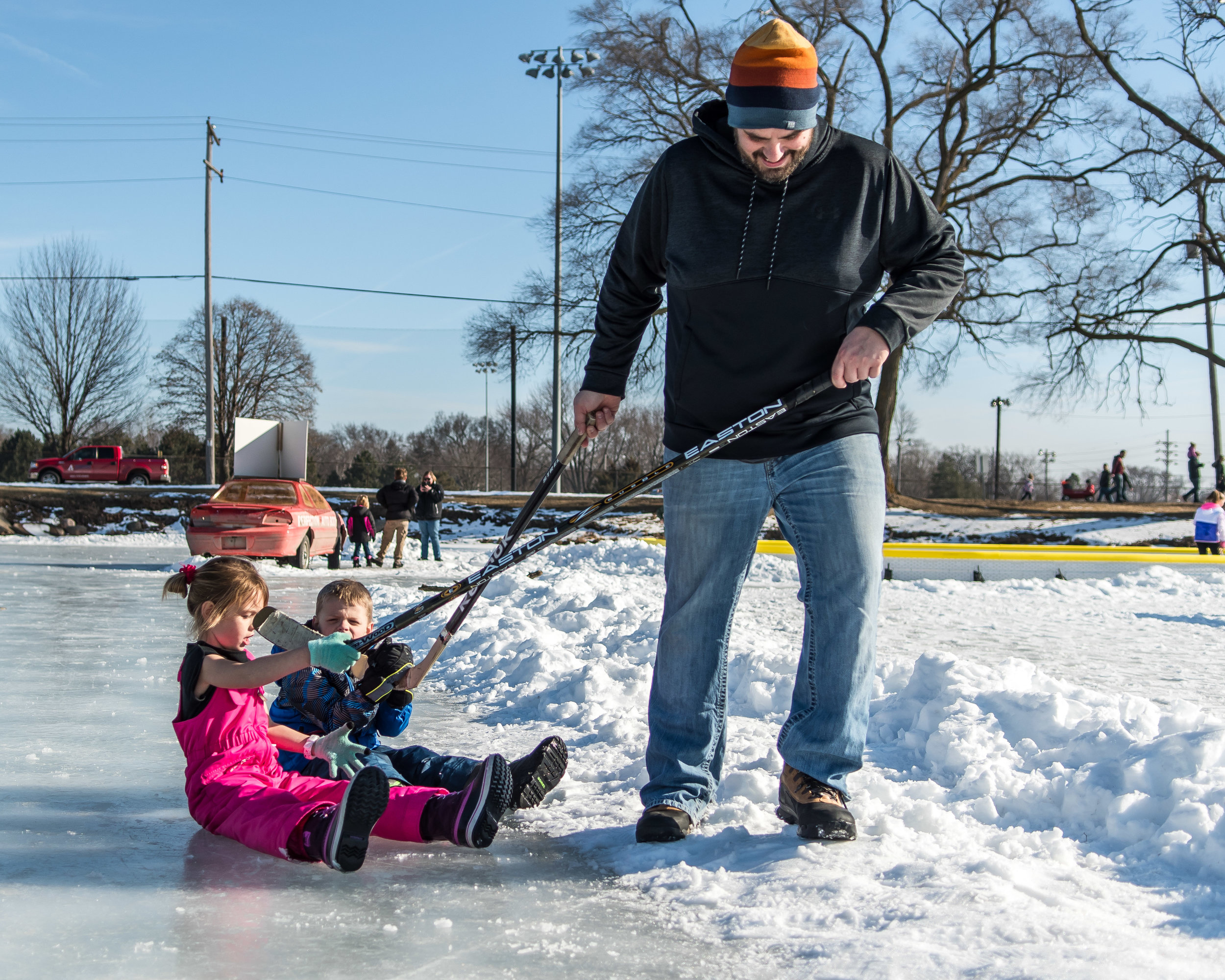 Jim Pavlich, Burlington, tows his kids Nora, 7, and Nathan, 6, around the ice of Echo Lake Saturday afternoon during Burlington's Hot Chocolatefest.