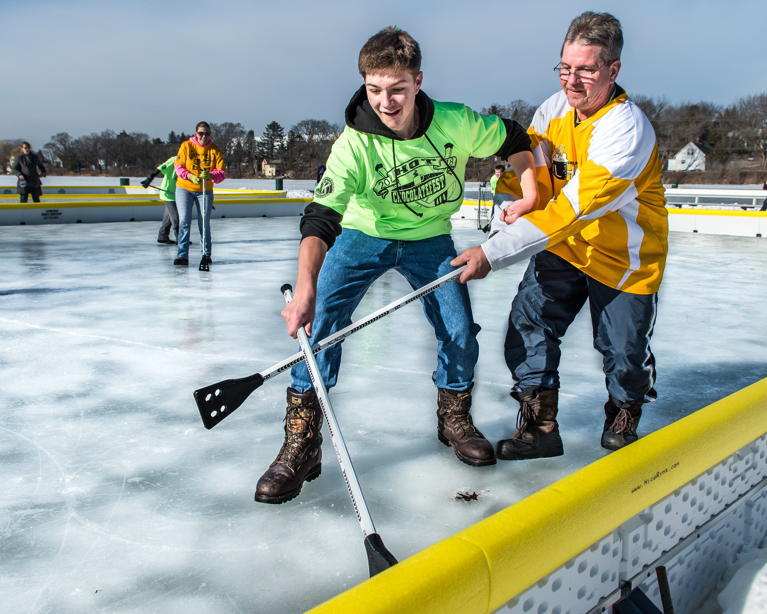 Matthew Oliver, 14, attempts to swipe the ball away from Bob Prailes during an adults versus kids game of Broom Ball on Echo Lake during Burlington's Hot Chocolatefest Saturday afternoon.