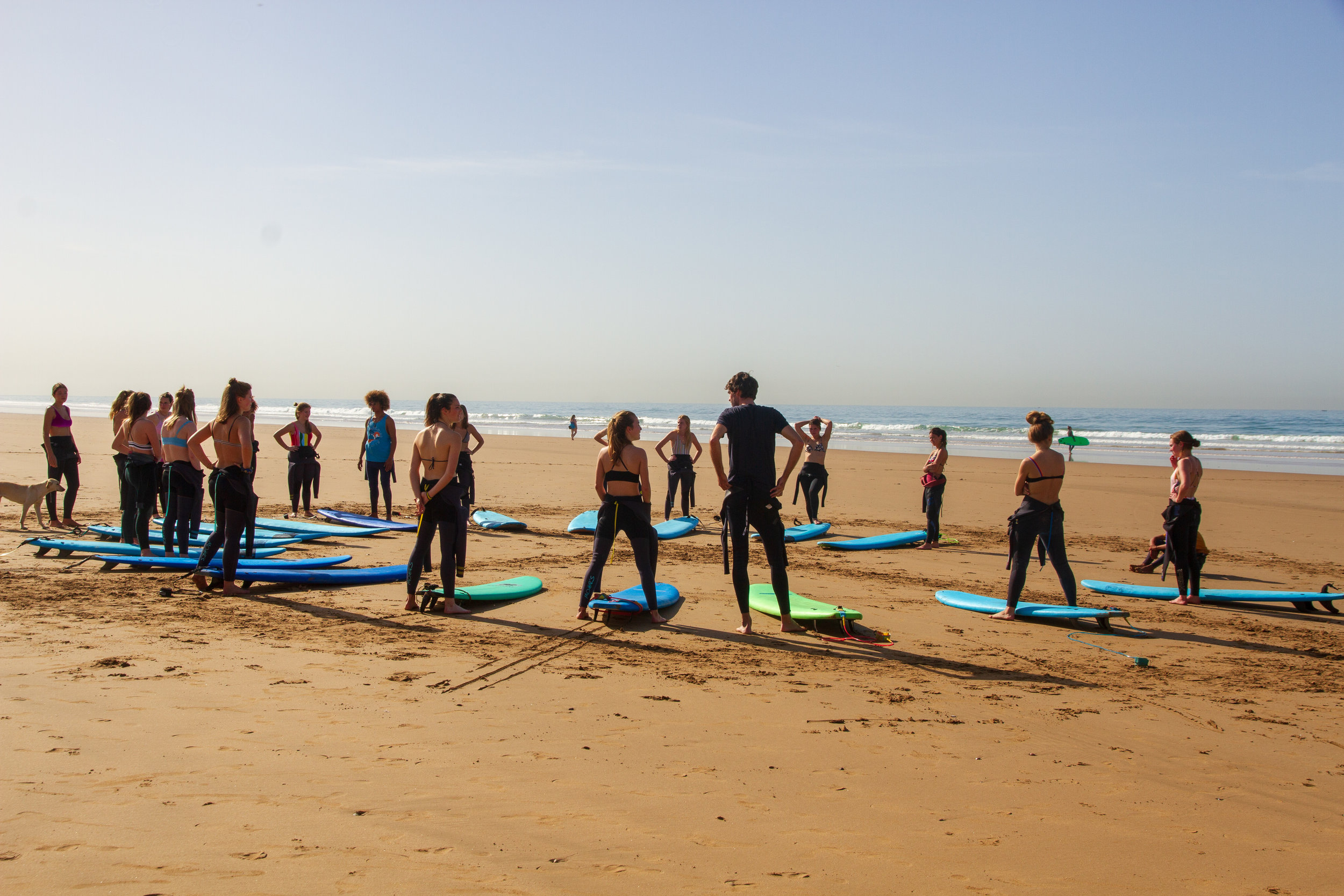 Large group of people enjoying surf lesson taghazout Morocco