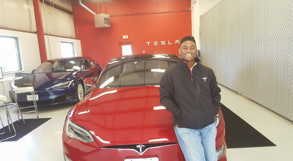 Jermaine is a proud owner of a Red Tesla Model S!