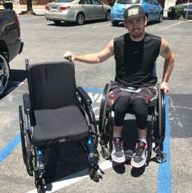 Troy receiving the Motion Composites Helio C2 wheelchair