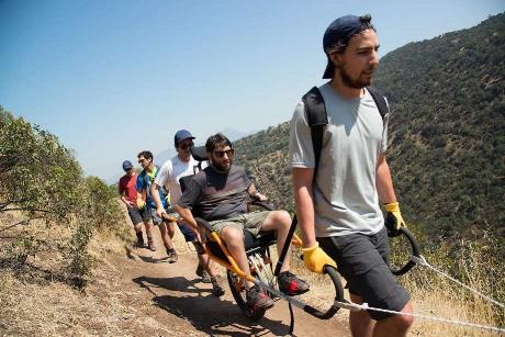 Alvaro in the special trekking wheelchair designed for hikes.