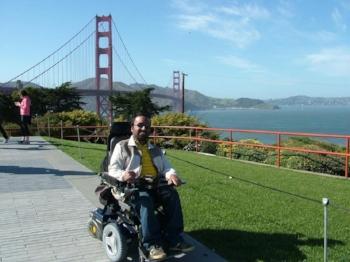 Srin posing across from the Golden Gate Bridge