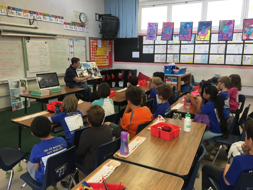"""Chris at his kids' elementary school during their annual """"My Daddy's Wheelchair"""" program talking about disability."""