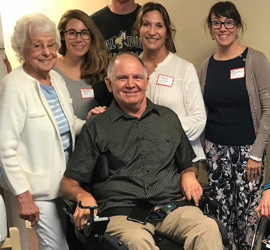 Mae (on the left) and Mike in the center, surrounded by members of NorCal SCI's Mobile Clinic team in 2018.