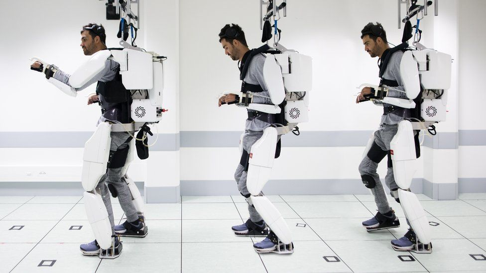 "When he thinks ""walk"", it sets off a chain of movements in the robotic suit that move his legs forward."