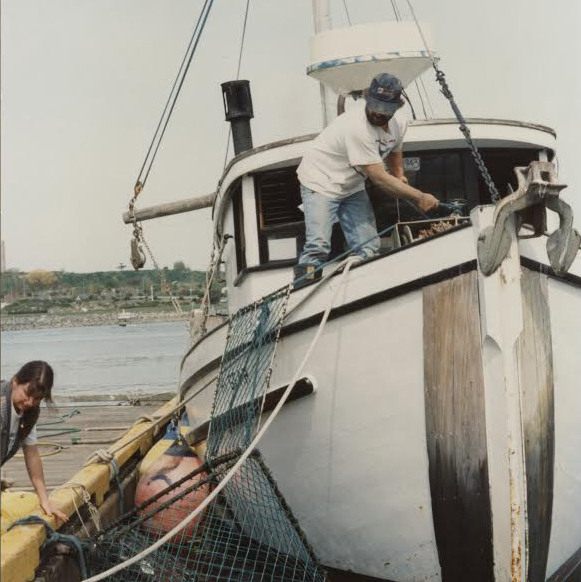 Fisherman's Wharf in the early 1990s. Tim and Margaret working on the original Hi Gear.