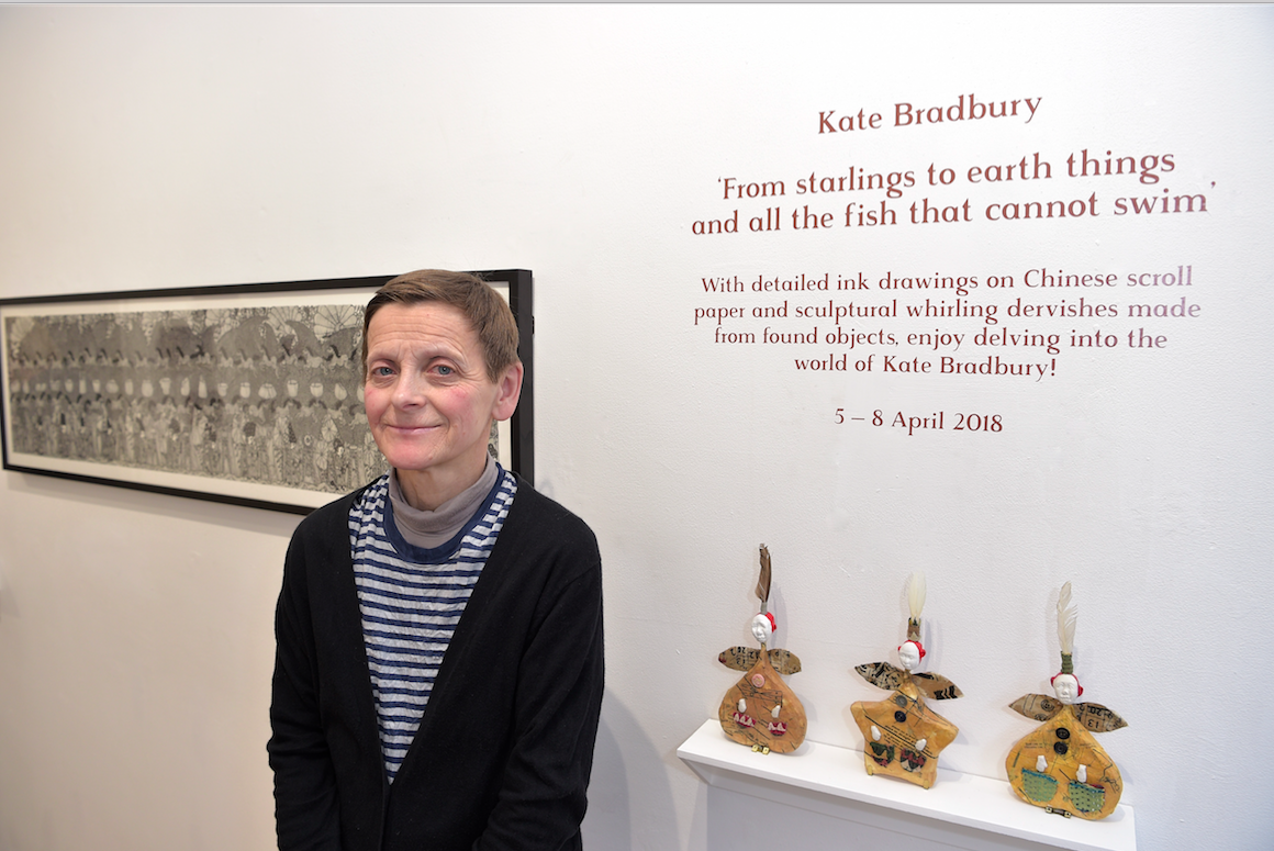 Kate Bradbury standing in her exhibition Photograph by Andrew Hood