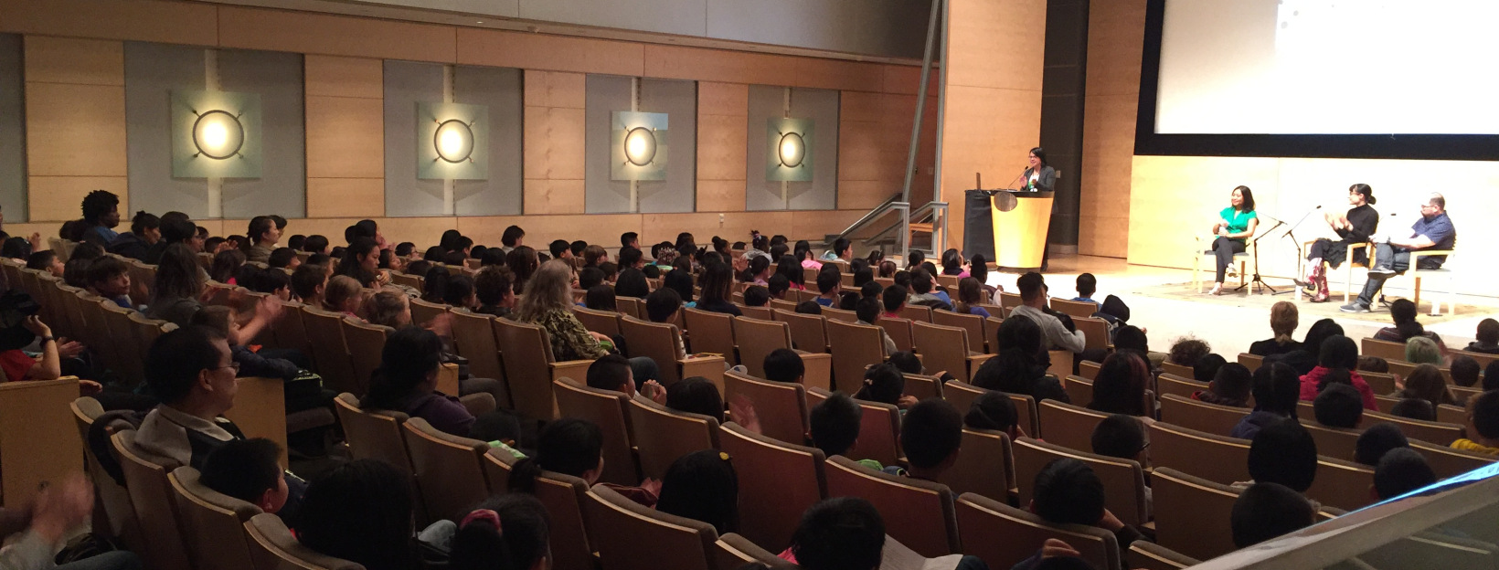 Mae (in the green!) presenting with author friends Jill Diamond and Alexis Fajardo to 500 amazing students at San Francisco's #Kidquake!  Photo credit: Jilanne Hoffman Blog