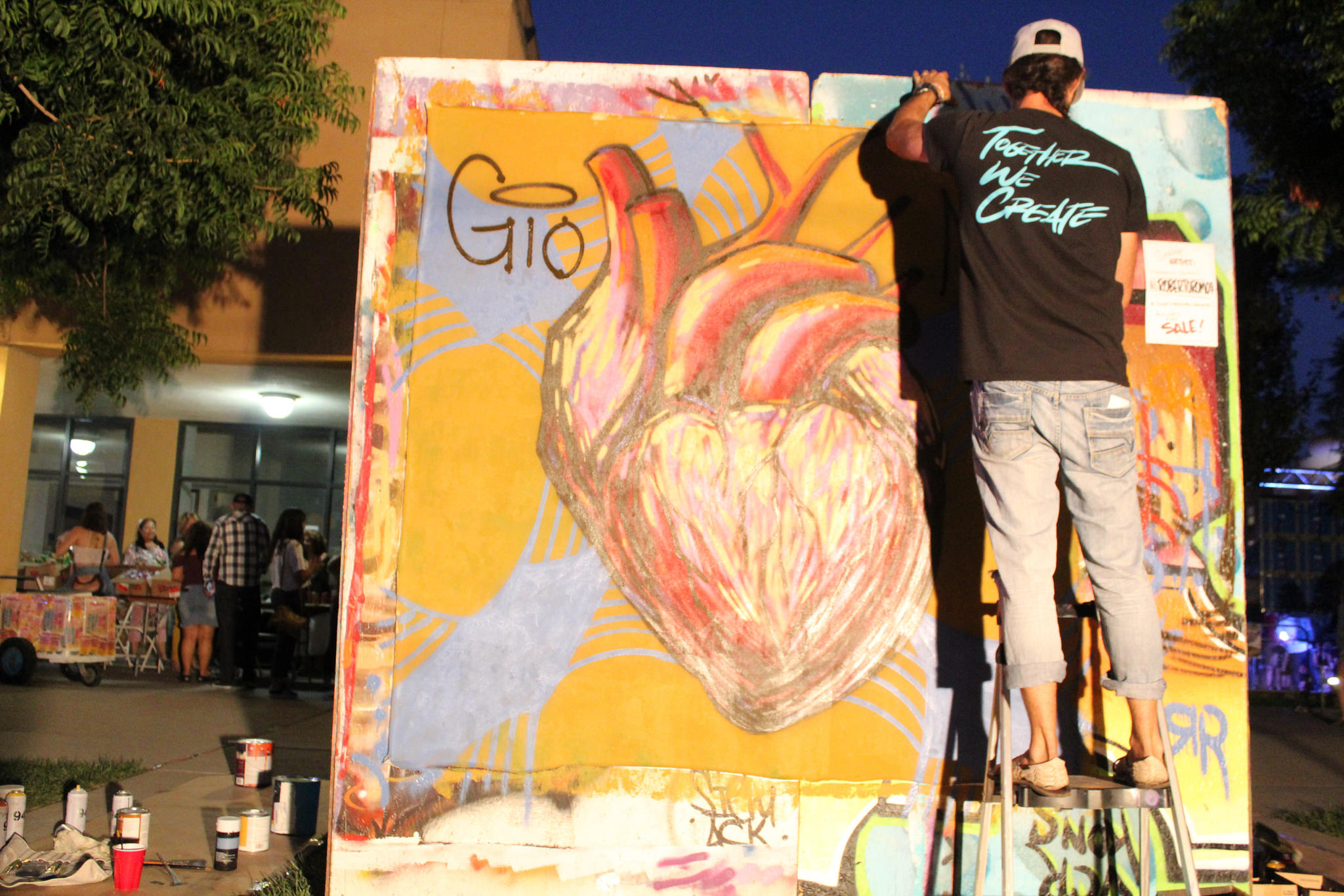 Live painting by Roberto Romo from Together We Create, a collective of educators and artists. Photo by Orlando Espino.