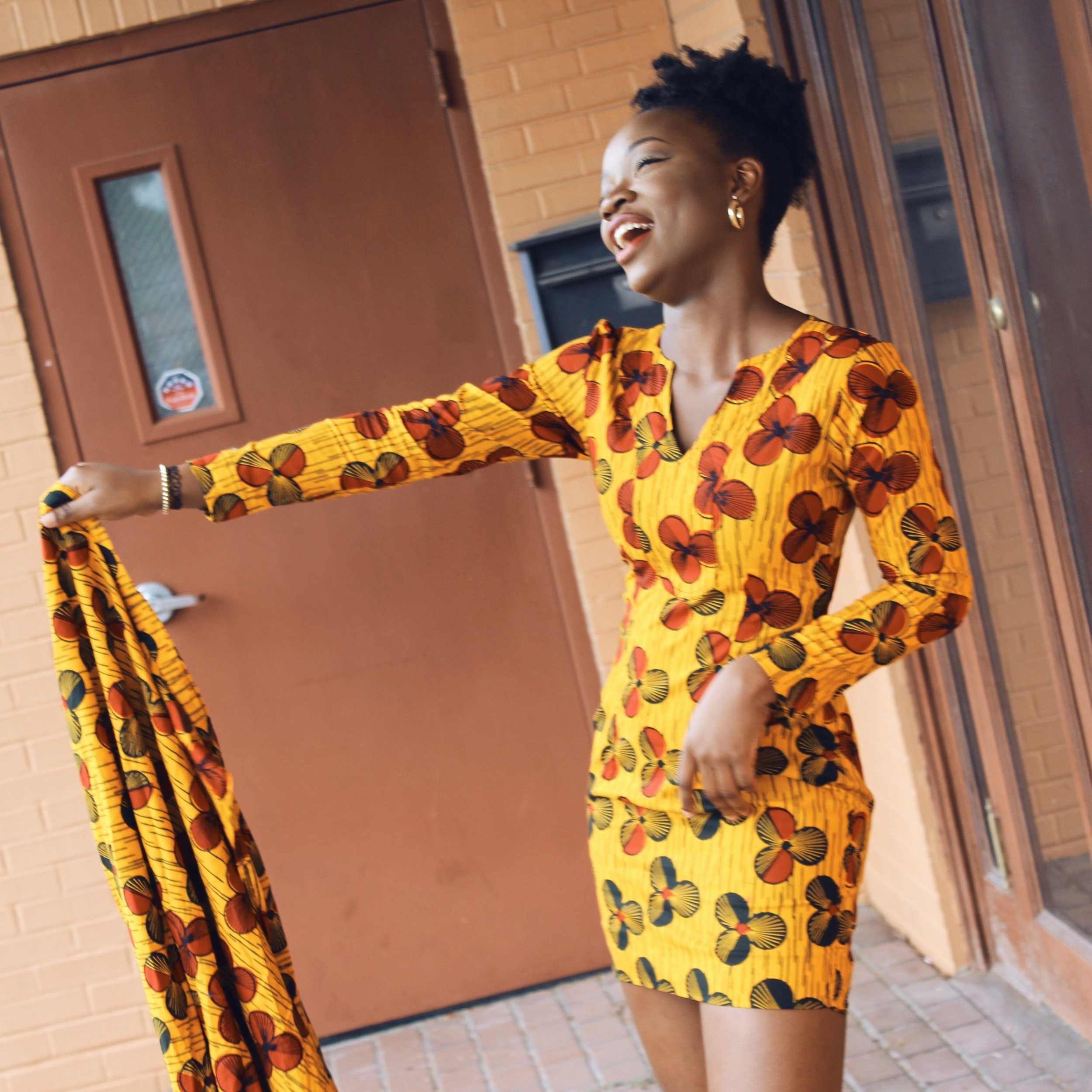 smiling african with ankara dress