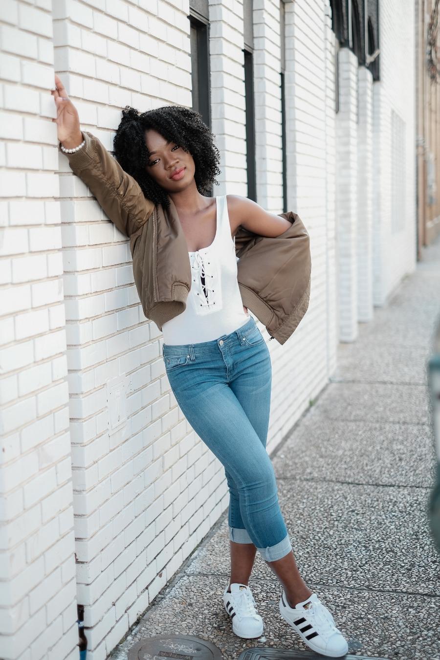 smiling black girl-white top-adidas women-posed