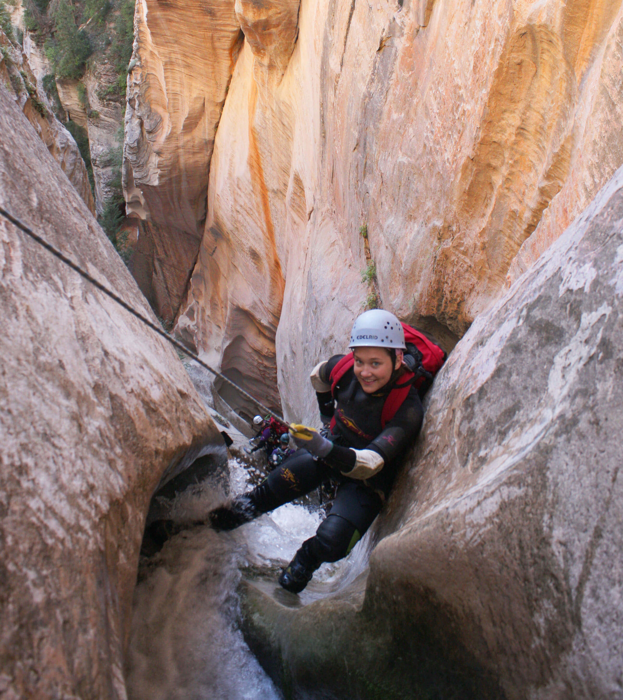 Amy rappelling in a Utah slot canyon.