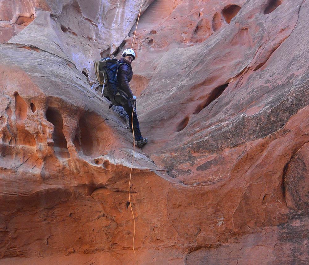 Alane descending the first rappel