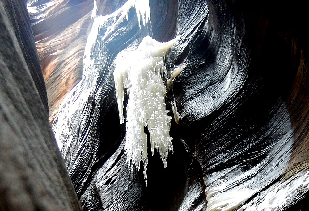 Ice overhanging and dripping