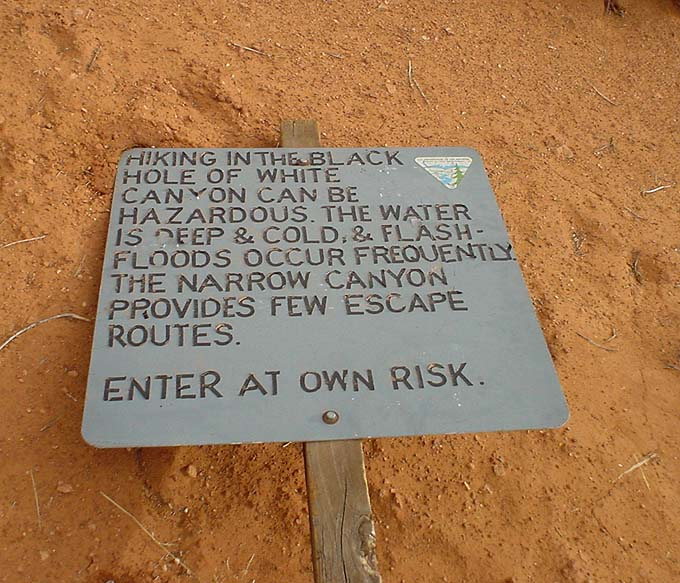 Here's the Warning Sign, laying in the sand. (North Wash Slots and Black Holes)