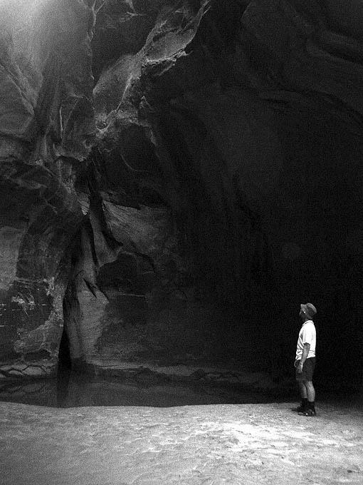 Hank Moon looking up at the canyon exit. (night)