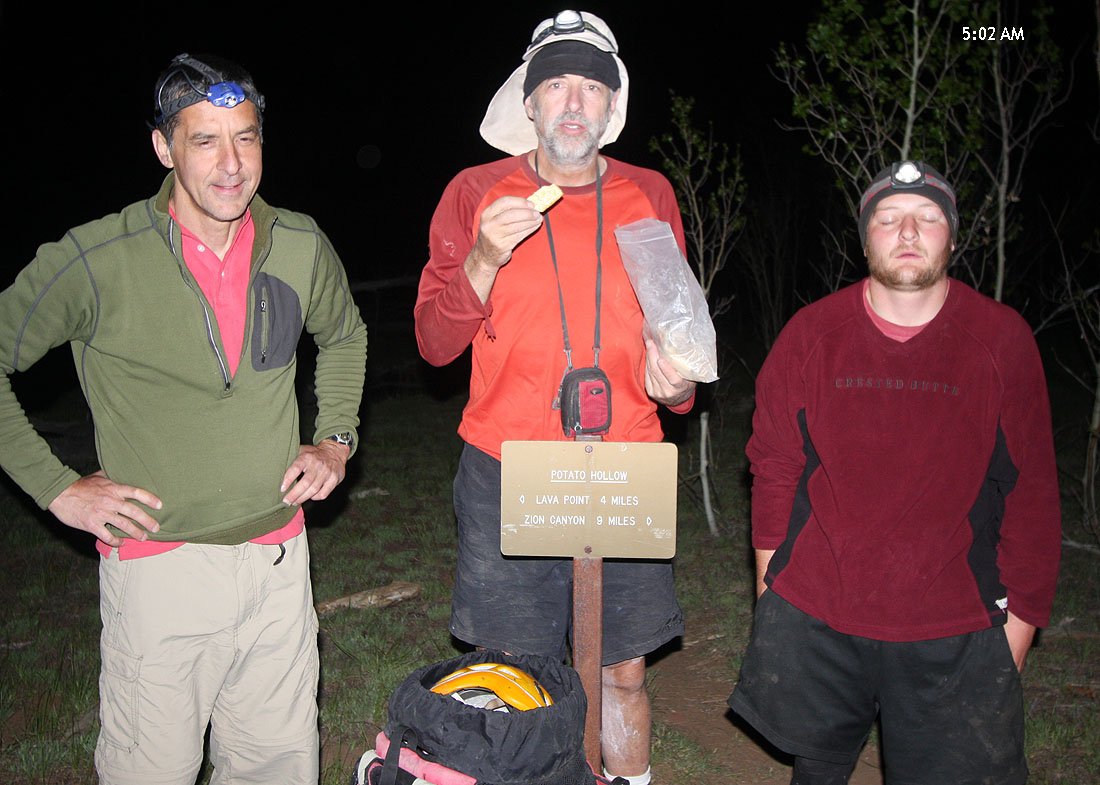 Five in the morning - Nat is uncertain, Matt is still asleep, and Ram is wolfing down Triscuits. At Potato Hollow. (Zion)