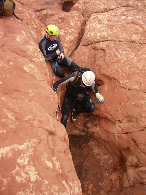 Tom assisting Ram down a short climb, upper canyon. (night)