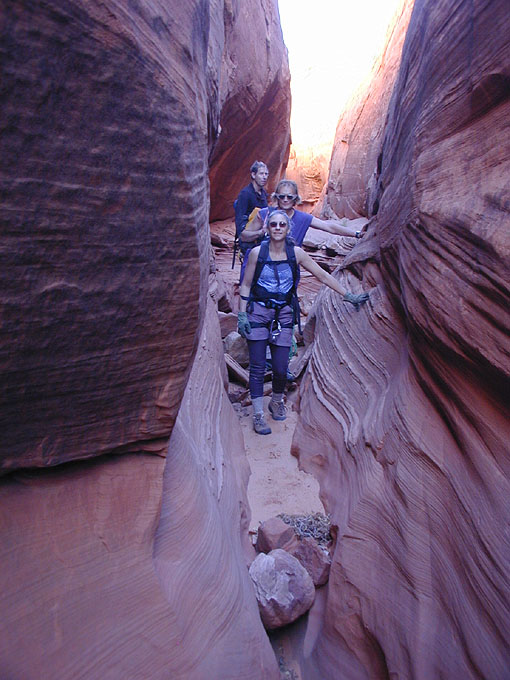 And we drop into the canyon head. The canyon starts with nice, banded narrows. Deb Davis, Dave Black and Steve Lewis. (Leprechaun Canyon)