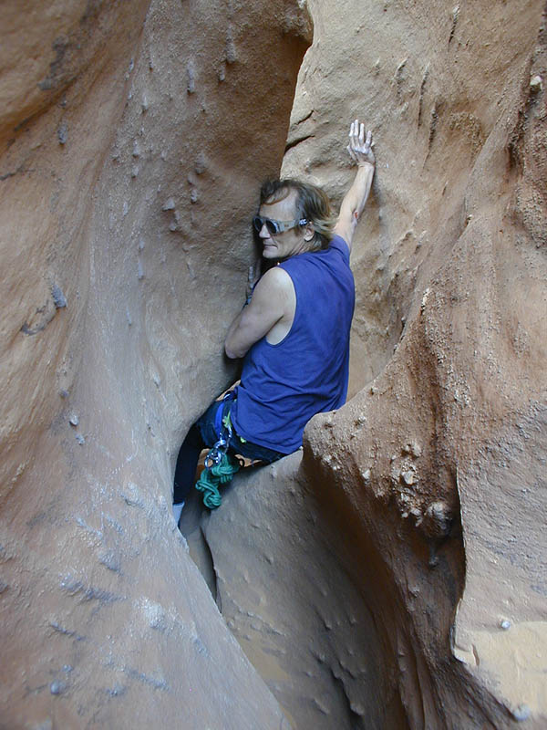 A couple of short rappels, some interesting squeeze, a few narrow places - all good stuff, but not many pictures taken. Here Dave Black starts down into a squeeze section. (Leprechaun Canyon)