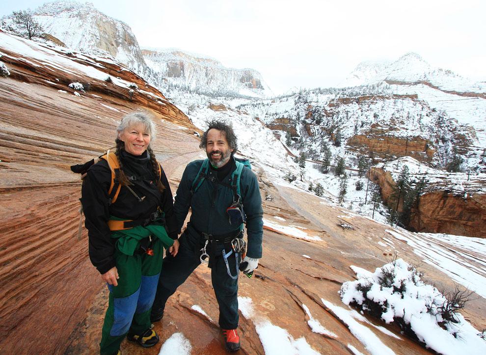 Jenny and Deeps hiking up the slickrock